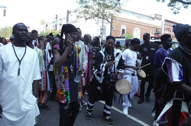 Parade of African drummers on a city street
