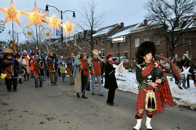 Scottish bagpiper performing at winter festival in the street