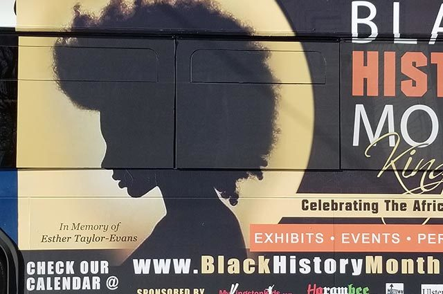 Poster advertising Black History Month Events with a silhoutte of a person with an afro hairstyle