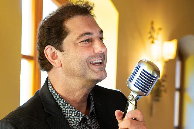 Close up of singer performing at standing microphone