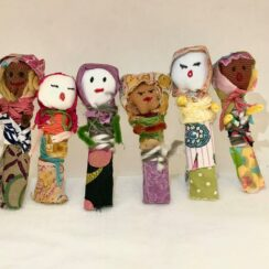 Group of colorful handcrafted worry dolls.